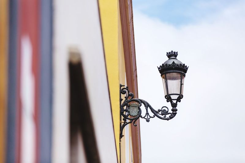 Low angle view of gas light on wall