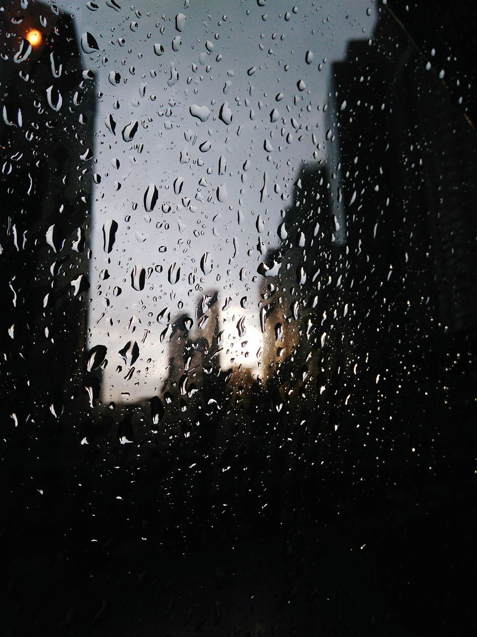 drop, window, wet, glass - material, rain, water, vehicle interior, rainy season, glass, raindrop, car interior, weather, car, indoors, no people, land vehicle, droplet, mode of transport, windshield, transportation, illuminated, looking through window, close-up, night, sky