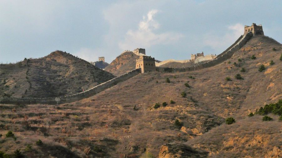 View of fort on mountain against cloudy sky