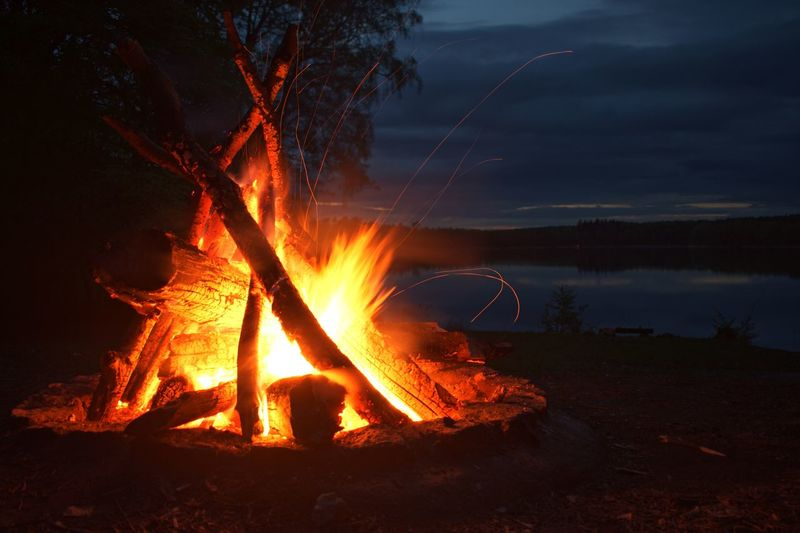 Lakeside Summer Evening Long Exposure Heat - Temperature Fire Burning Flame Fire - Natural Phenomenon Night Orange Color Nature Glowing Land Sky Bonfire Motion Campfire No People Outdoors Water