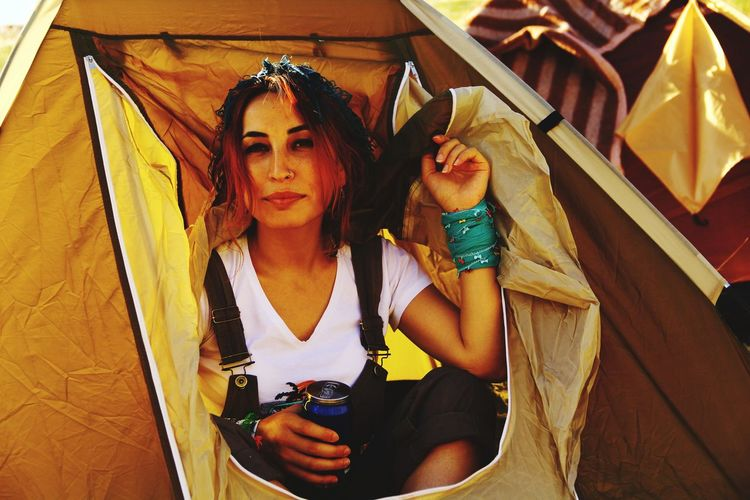Portrait of woman sitting in tent