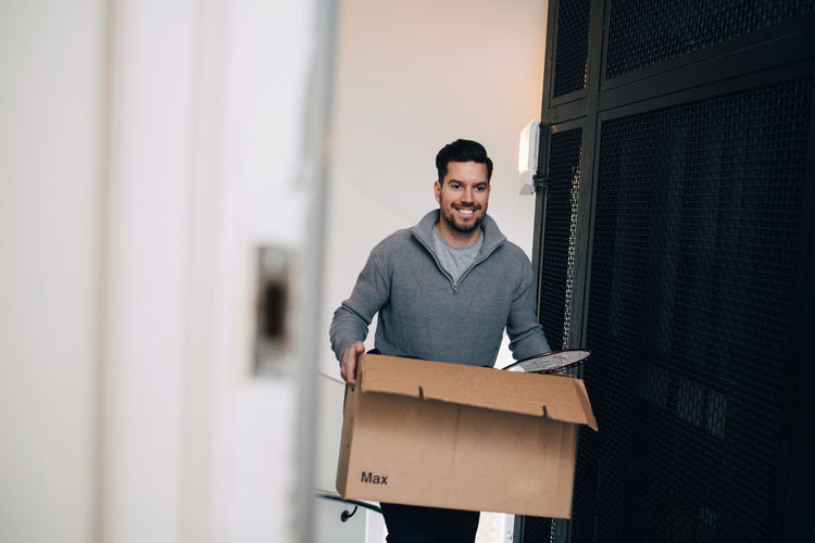 Young man standing in a box