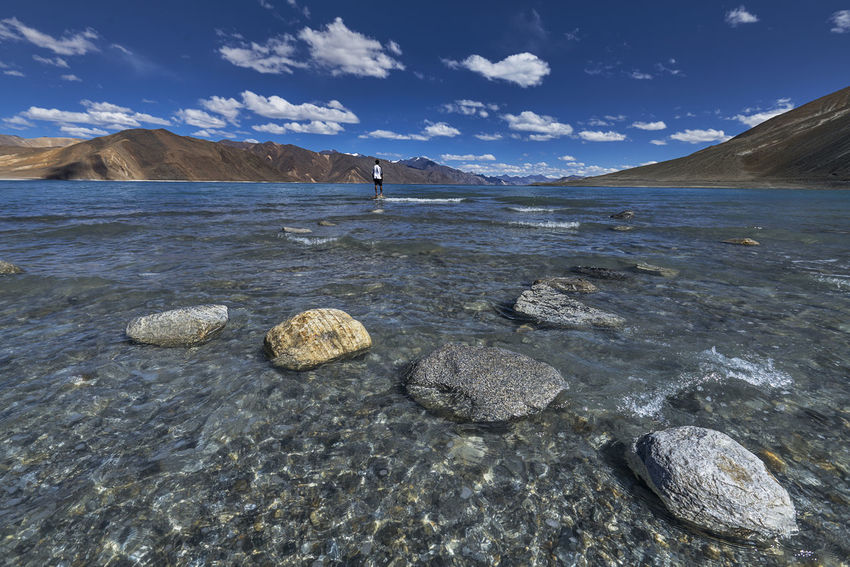 The clear waters of the beautiful Pangong Lake, Ladakh, India. Beach Day Lake Mountain Mountain Range Mountains Mountains And Sky Mountais And Lake Nature No People Outdoors Rock - Object Rocks Rocks And Water Sea Sky Sky And Clouds Skyporn Water Wave