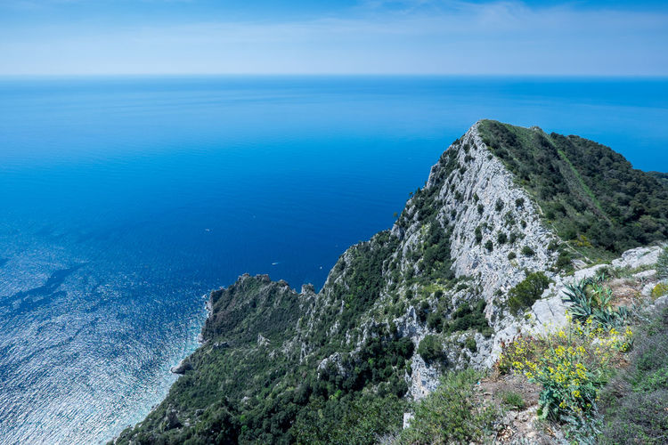 The cliffs of Capri, Italy Sea Water Scenics - Nature Beauty In Nature Tranquil Scene Horizon Over Water Tranquility Sky Rock Horizon Nature Blue Day Rock - Object No People Land Plant Solid Idyllic