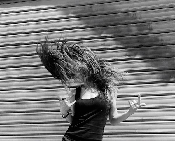 Let Your Hair Down Rock Black & White Shoot Shooting Good Shot Streetphotography The Street Photography - 2016 EyeEm Awards Hair Hairstyle Long Hair The Portraitist - 2016 EyeEm Awards Street Photography Picturing Individuality Woman Portrait Woman Hair In The Wind Movement Photography Movement My Favorite Photo
