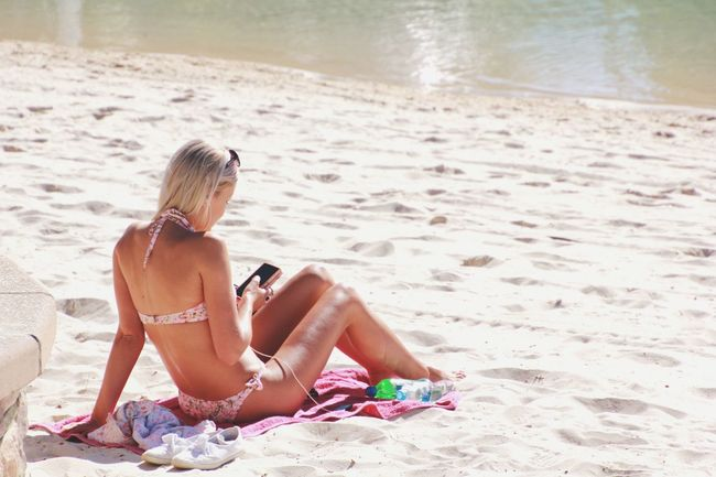 Young woman at the beach using a mobile device Mobile Devices Woman Young Women Young Woman Bikini Beach Sand Summer Summertime Phone People Photography Female People Technology Australia Brisbane South Bank, Brisbane, Queensland !  Blonde Showcase July People Together Internet Addiction People And Places Mobile Conversations Women Around The World Millennial Pink