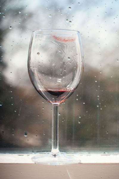 A nearly empty, lipstick-stained wineglass. Alone Beverage Lipstick Loneliness Raining Red Wine Stained Glass Alcohol Close-up Day Drink Drinking Drinking Glass Solitude Wine Wineglass