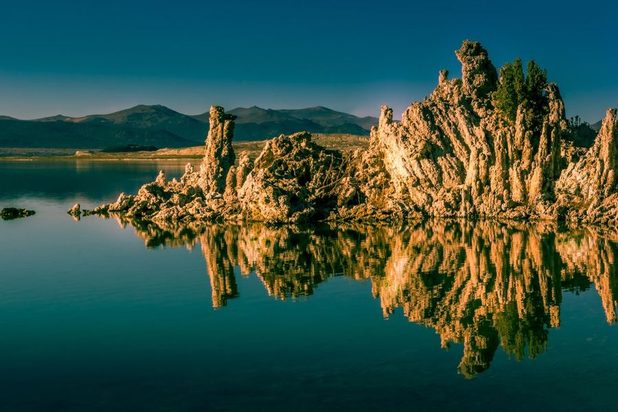 Travel Tourism Travel Limestone Tuff Mono Lake California The Week On EyeEm Reflection Water Lake Beauty In Nature Waterfront Scenics Mountain Nature Mountain Range Outdoors Tranquil Scene Tranquility Clear Sky Day California Dreamin