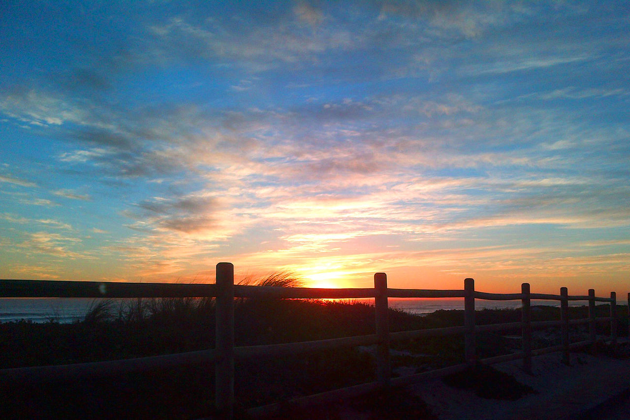 sky, sunset, cloud - sky, beauty in nature, scenics - nature, orange color, tranquility, barrier, boundary, fence, tranquil scene, nature, silhouette, railing, water, no people, land, sun, security, outdoors