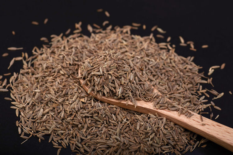 Cumin seed over Black background with wooden spoon. Top view Still Life Close-up No People Food And Drink High Angle View Food Indoors  Large Group Of Objects Freshness Wellbeing Seed Healthy Eating Abundance Spice Dry Wood - Material Black Background Raw Food Plant Studio Shot Dried