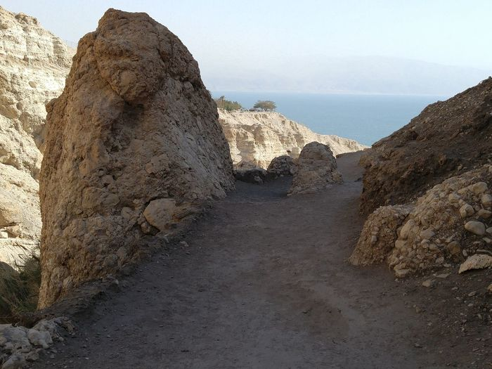 Pathway amidst rock formations at ein gedi