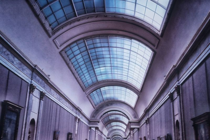 Architectural Column Architectural Feature Architecture Building Built Structure Ceiling Column Day Design Diminishing Perspective Directly Below Full Frame Geometric Shape Interior Louvre Louvremuseum Low Angle View Modern Museum No People Repetition Sky Skylight Travel Destinations Urban