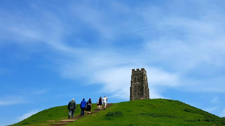 Rear View Of People At St Michael Tower On Glastonbury Against Sky
