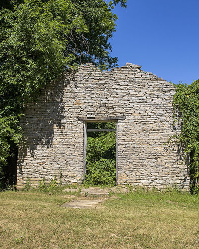 An abandoned stone church in a rural area. Church Abandoned Stone Church House Of Worship Rural Scene Rural Decay Vintage Weathered Rustic Architecture Built Structure History The Past Stone Wall Deterioration Wall Building Exterior Tree Ruined Outdoors Building No People Day Nature