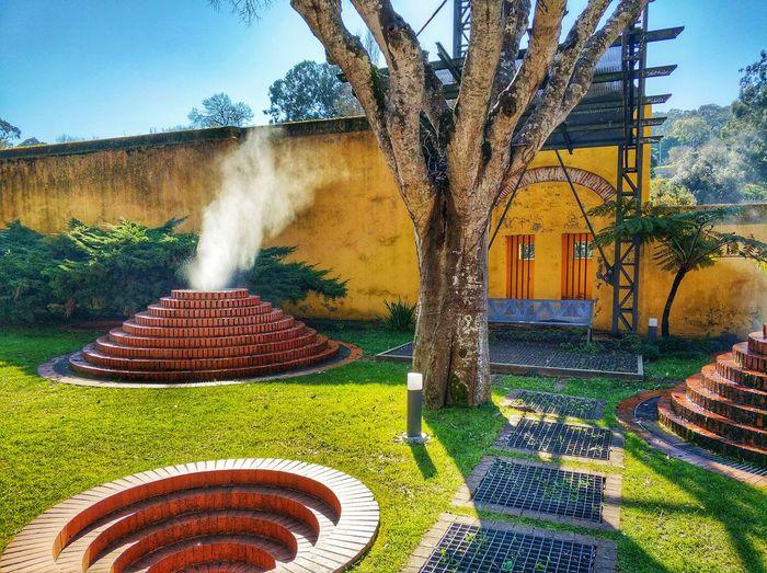 Is it a volcano!? Fabrica Da Polvora Building Colorful Colors Tree Spraying Grass Sprinkler Irrigation Equipment Bonfire