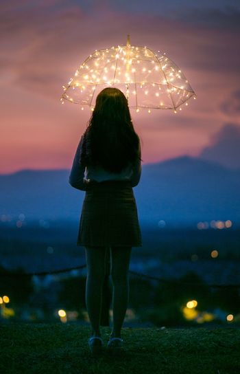 Girl looking down at the small city scenery City View  Pretty Girl Night Sky Night View Mountain View Fairy Lights Light Japan Asian Woman Night Sky Illuminated My Best Photo