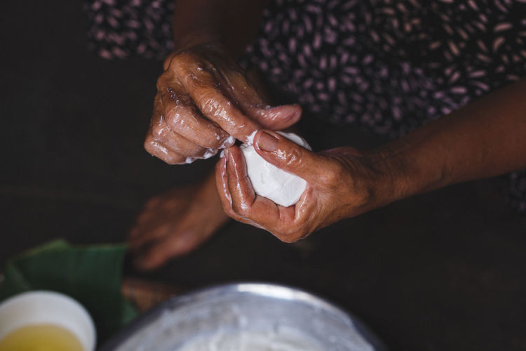 High angle view of woman making rice cake