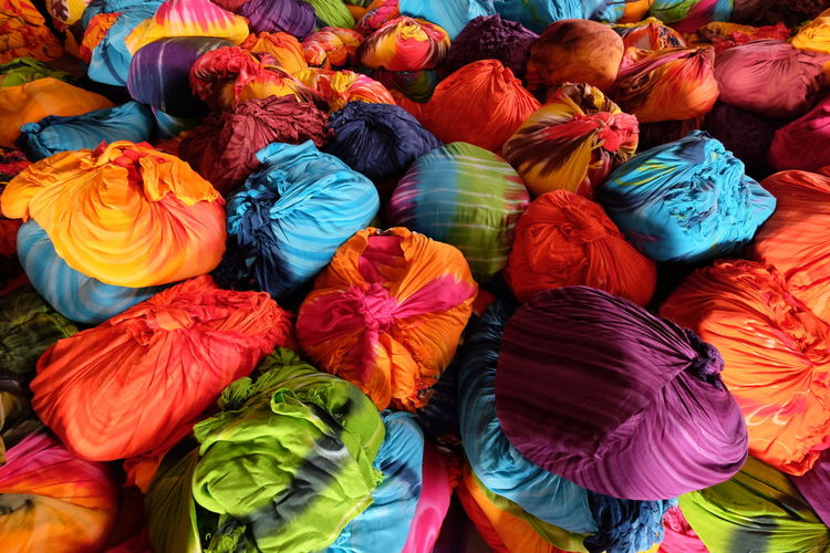 Colorful textile Multi Colored Market For Sale Retail  Variation Choice Backgrounds High Angle View Full Frame No People Abundance Market Stall Large Group Of Objects Close-up Day Textile Arrangement Still Life Pattern Collection Sale Retail Display Consumerism