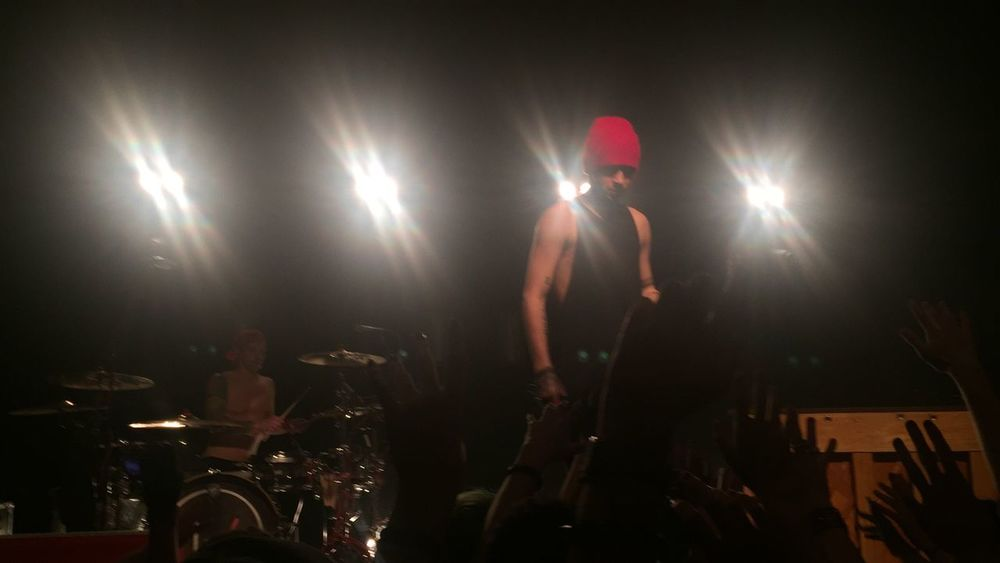 Arts Culture And Entertainment Performance Standing Music Night Youth Culture Stage - Performance Space Illuminated Real People Indoors  Skill  Playing Occupation Men Rock Music Nightlife Spotlight Drum Kit Singer  People Twenty One Pilots Tyler Joseph Josh Dun Concert Lyon