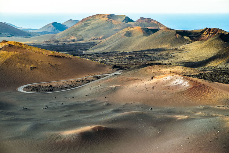 Lanzarote in Canary Islands Spain Arid Climate Beauty In Nature Coastline Day Desert Europe Geology Idyllic Landscape Lanzarote Mountain Mountain Range Nature Non-urban Scene Physical Geography Remote Sand Scenics Sky SPAIN Tourism Tranquil Scene Tranquility Travel Destinations Water