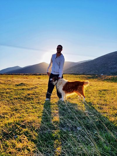 One Man Only One Person Adult Field Agriculture Outdoors Standing Day Sky Rural Scene Nature Clear Sky Dog Border Collie Collie Bordercollie  Animals Sunnyday EyeEmNewHere Naturelovers Green Sun Nature