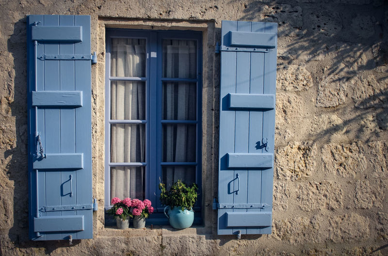 French House Architecture Blue Building Exterior Built Structure Day Door Flower Nature No People Old House Outdoors Plant Shutter Window Window Box