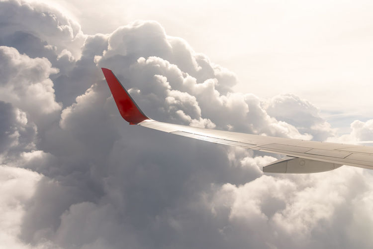 Cloud - Sky Airplane Sky Air Vehicle Flying Transportation Mode Of Transportation Nature No People Low Angle View Day Aircraft Wing Mid-air on the move Travel Motion Outdoors Beauty In Nature Scenics - Nature Cloudscape Aerospace Industry