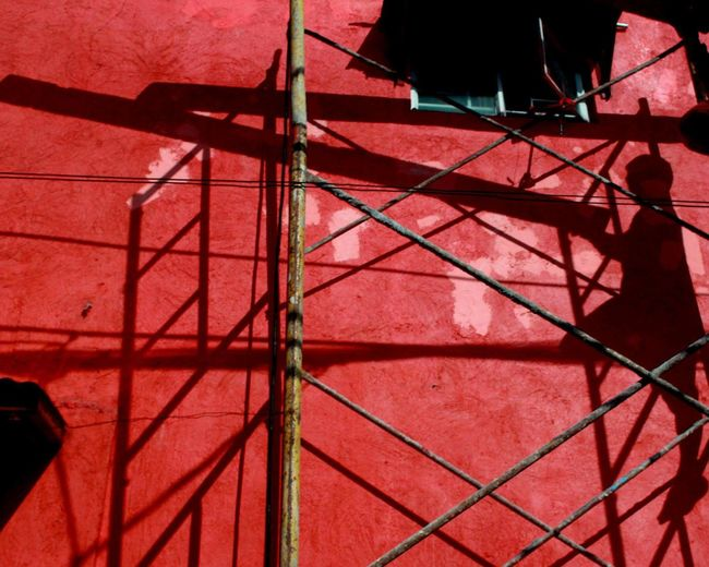 Low angle view of red wall