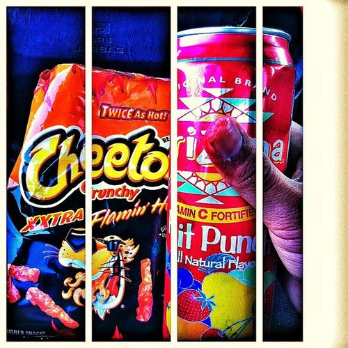 Snacking down before work Hot Cheetos And Arizona fruitpunchflavorextrahotsnacks