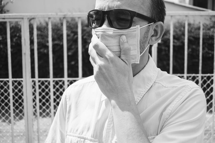 Men wearing surgical masks to prevent respiratory diseases, portrait of a man scared of covid-19.