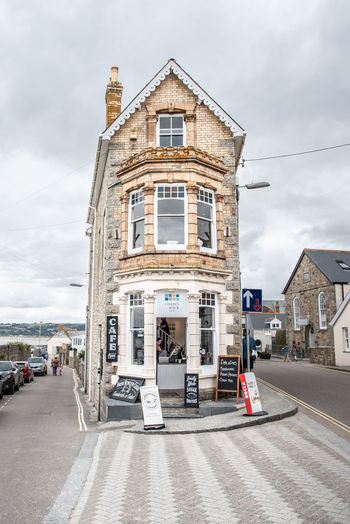 One of the small seaside houses in Marazion, struggling against the increasing traffic demand. Oriel Architecture Building Building Exterior Built Structure City Cloud - Sky Day English Incidental People Outdoors Road Sky Small House Street Architecture Building Building Exterior Built Structure City Cloud - Sky Day English Incidental People Outdoors Road Sky Small House Street
