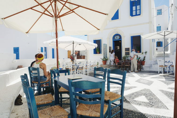 Greek Islands Nikia Square Architecture Building Exterior Built Structure Centre Chair Day Greece Nisyros One Person Outdoor Cafe Outdoors People Place Setting Real People Restaurant Sitting Table