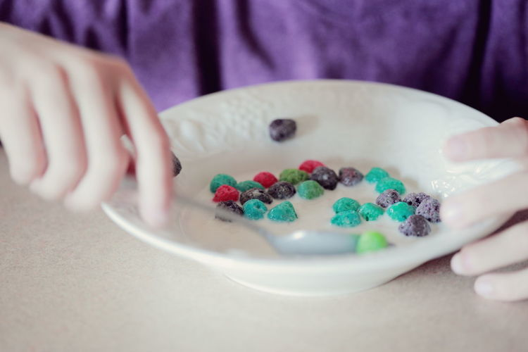 Bowl Breakfast Cereal Child Childhood Close-up Eating Food Food And Drink Freshness Hands Indoors  Meal Milk Multi Colored People Person Ready-to-eat Sweet Food