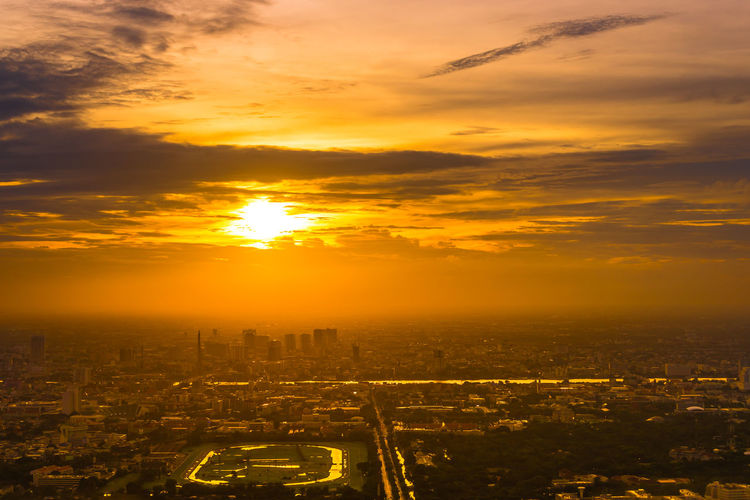 sunset over the capital city Capital Cities  City Cityscape Urban Skyline Sunset Skyscraper Modern Business Horizon Business Finance And Industry Gold Colored