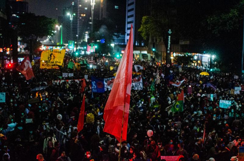 Crowd on city street at night