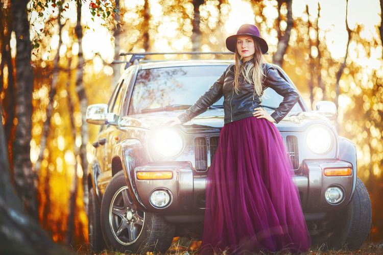 Artistic and natural portrait of beautiful woman in the nature. Woman Face Portrait Beautiful Beauty Smile Female Girl Young Hair Natural Nature Outdoors Skin White Happy Attractive Background Lifestyle Fashion Cute Autumn Light Dress Skirt Mode Of Transportation Transportation Car One Person Young Adult Land Vehicle Looking At Camera Motor Vehicle Front View Women Tree Clothing Young Women Real People Beautiful Woman Lifestyles Hairstyle