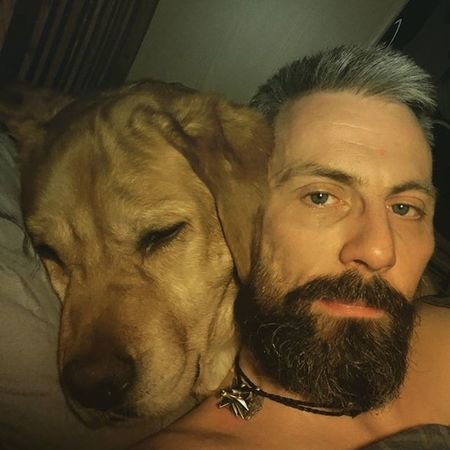 He's so lazy..he will put up with this for about 5 minutes before finally giving up and taking himself off to his own bed. Beardsandtattoos Greyhair  Bpdfam Bearded Beardporn Uk Beards Beard Pognophiles Smile Beardgame Beardandcompany Beardedmen Beardlovers Hugs Sleeping Instabeard Motörhead Livetowin Metalhead Volbeat ACDC Bedtime Aceofspades Dog labrador cuddles