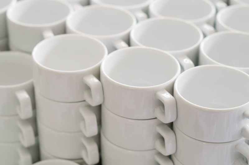 Porcelain  Abundance Arrangement Art And Craft Backgrounds Ceramics Close-up Cup Full Frame High Angle View In A Row Indoors  Large Group Of Objects Mug No People Order Pattern Repetition Stack Still Life Table White Color