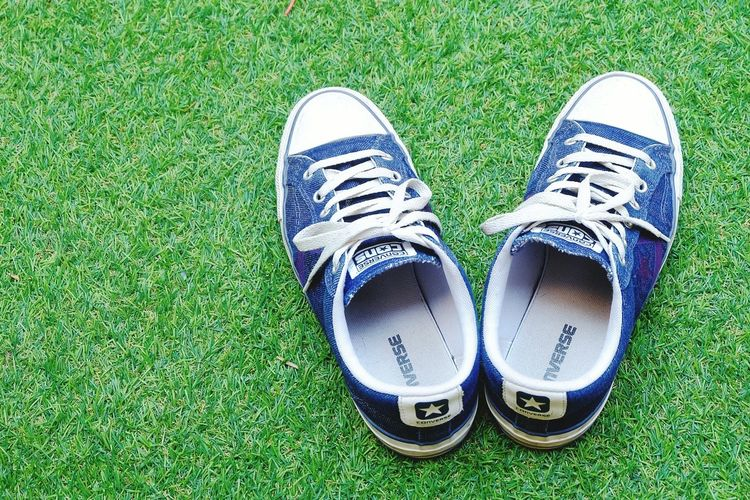 converse cons on greensward grassShoe Grass Human Body Part Green Color One Person Lifestyles Human Leg Pair Sport Adult Adults Only Outdoors Day Onestar One Star Converse Backgrounds Green Background Background Textured  Nature Lawn Green Sward Adult Grass