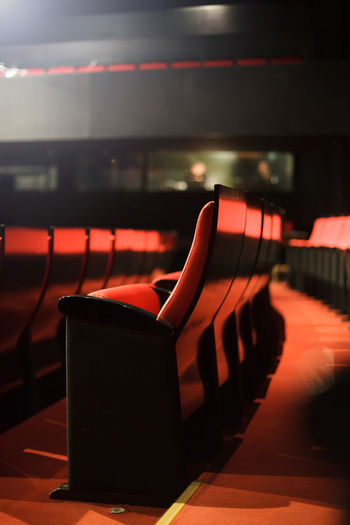 red seats at the theater Theater Red Seats Empty Cinema Interior Inside Culture Arts Opéra Traditional Indoors  Entertainment Event Hall Public Amusement  Leisure Nobody Rows Lights Decoration Pattern Chair Row Seat Classical Comfortable Background Furniture Show Fancy Formal Stage Audience Film Auditorium MOVIE Performance Showtime Conference Many Detail Modern Wooden Illuminated Side View Blurred Vertical