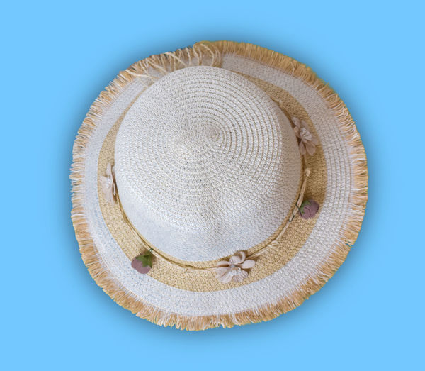 High angle view of hat on blue background