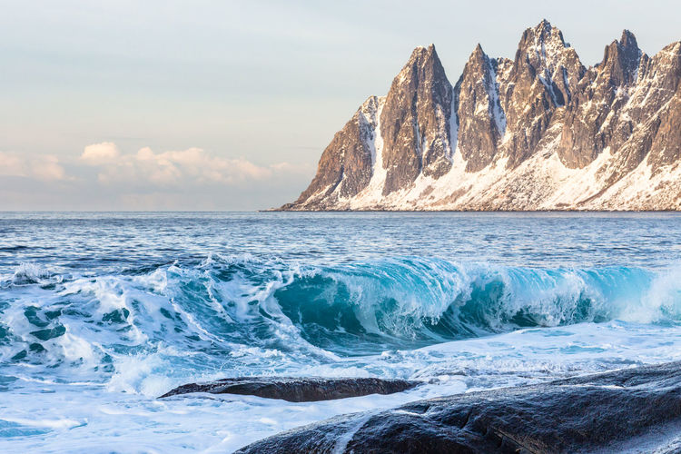 Northern Norway Norway Senja Island Wave Beach Beautiful Place Beauty In Nature Cliff Clouds Day Horizon Over Water Motion Mountain Nature No People Outdoors Rock - Object Scenics Sea Senja  Sky Splashing Tide Tranquil Scene Tranquility Water Wave The Great Outdoors - 2018 EyeEm Awards