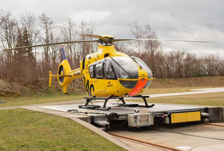 ADAC air rescue helicopter on the Helipad of the Hamburg airport ADAC Air Rescue Helicopter Landing Area Hamburger Airport Airplane Aviation Bolt Propeller Rescue Unit Rescue Rescue Organization Rescue Services Emergency Flight Airport Heliport Pilot Fly Transport Throttle