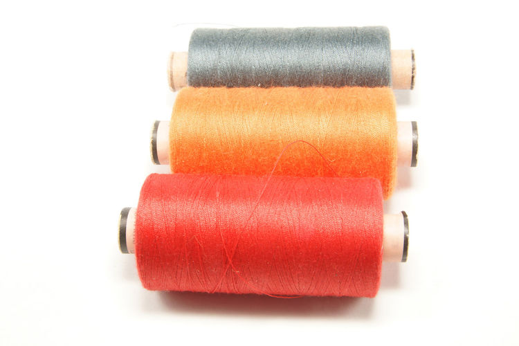 Industrial Orange Roll Bobins Close-up Colorful Cut Out Indoors  Multi Colored Red Spool Still Life Studio Shot Sweing Thread White Background