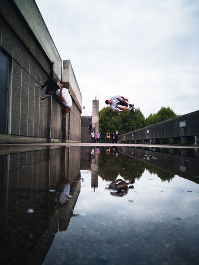 Southbank Reflections | Shot with the HONOR 10. Check This Out City City Life Exploring EyeEm EyeEm Best Shots Freerunning London Parkour Reflection Taking Photos Architecture Building Exterior Cloud - Sky Explore Honor 10 Mid-air Outdoors Puddle Reflection Reflections In The Water Street Streetphotography Travel Destinations Urban