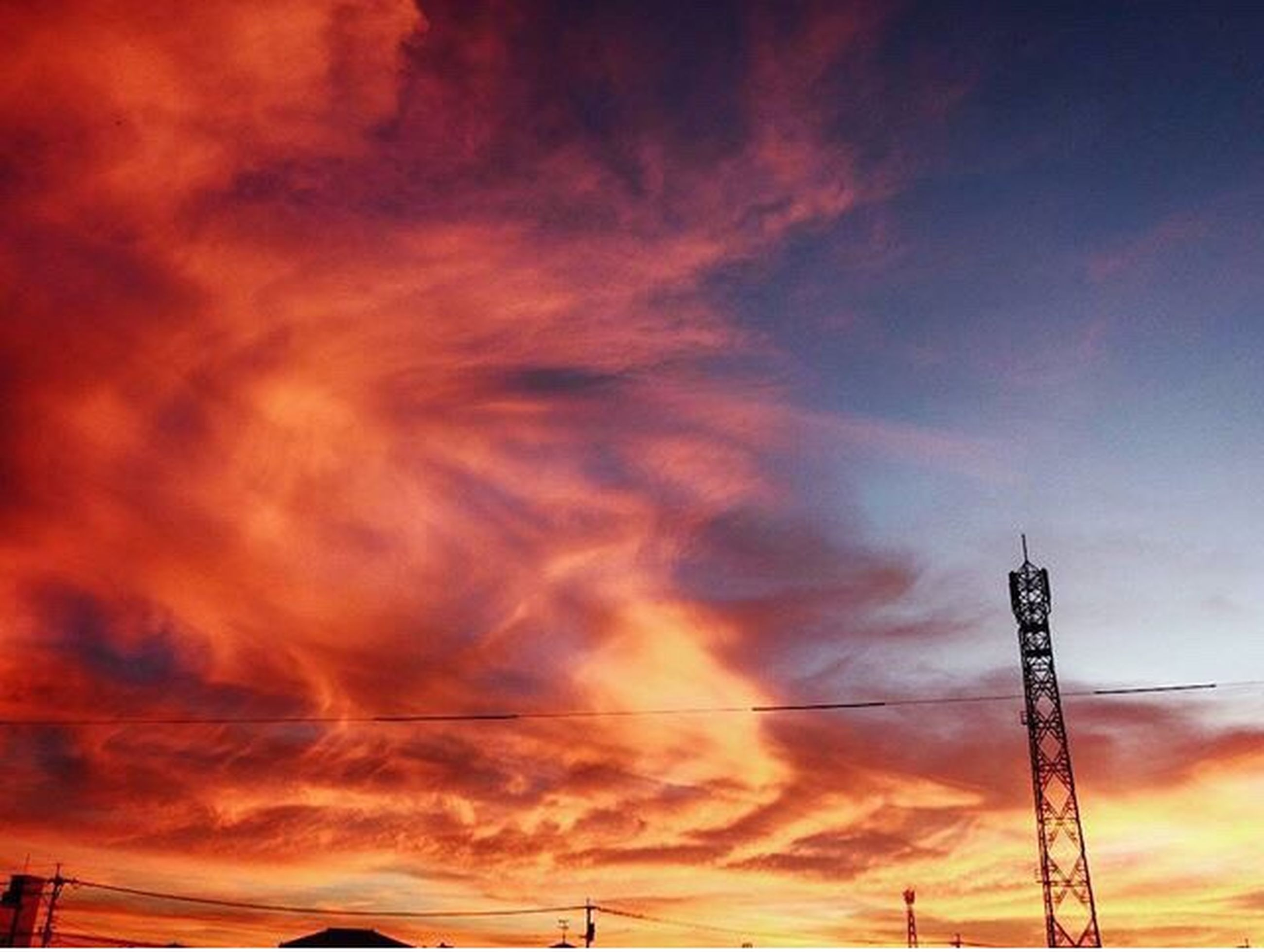 sunset, low angle view, sky, orange color, beauty in nature, cloud - sky, scenics, tranquility, power line, dramatic sky, nature, tranquil scene, cloud, cloudy, power supply, idyllic, outdoors, no people, majestic, weather, backgrounds