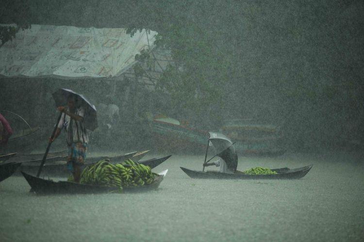 Wet umbrella on road during rainy season
