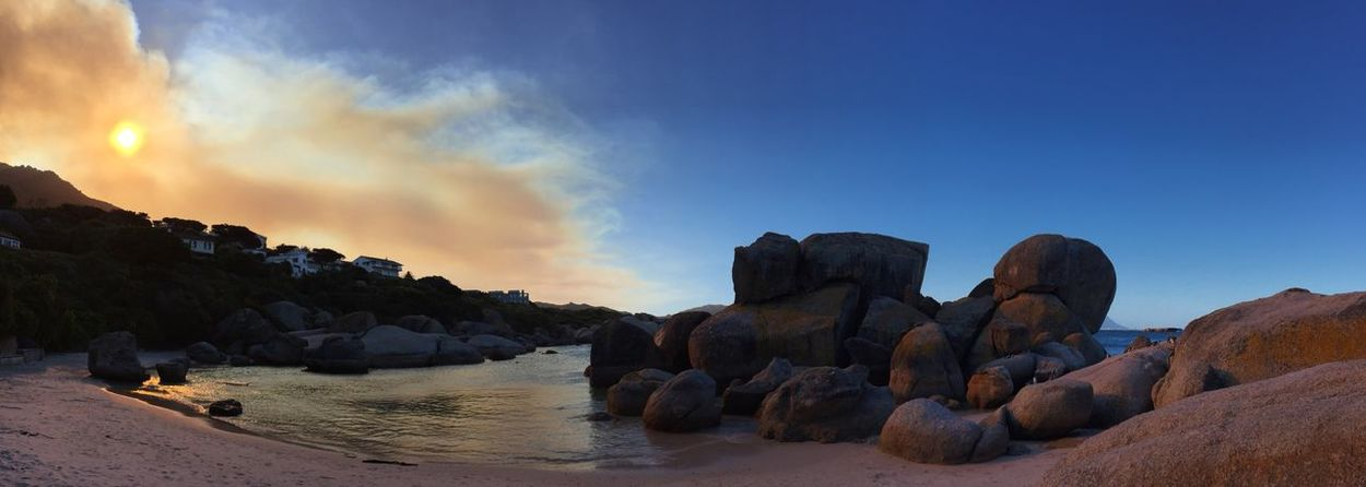 Bushfire above Boulders Beach Smoke Sun Behind Clouds Sunset No Edit/no Filter Rocks And Water Landscapes African Landscape Backlight Beach Scenery Sand & Sea Rock Formation Rock Cliff Beach Photography Strand Evening Sky Dusk Holiday Relaxing Tranquil Scene Tranquility Relaxing Moments
