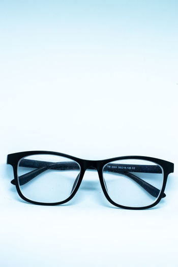 Close-up of eyeglasses against white background