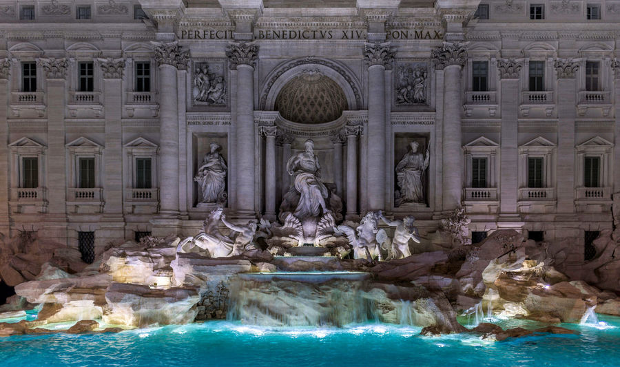 "Rome's most famous fountain (especially after Fellini's movie ""La Dolce Vita"") always draws a huge number of tourist. At night it is even more spectacular with the clear blue water illuminated by over 100 LED lights in stark contrast with the gray backdrop of Palazzo Poli Dolce Vita Fellini Fountain Rome Trevi Fountain TreviFountain UNESCO World Heritage Site Architecture Building Exterior Dolcevita  Famous Place Illuminated Italy Monument Night No People Sculpture Statue Tourism Travel Travel Destinations Water"
